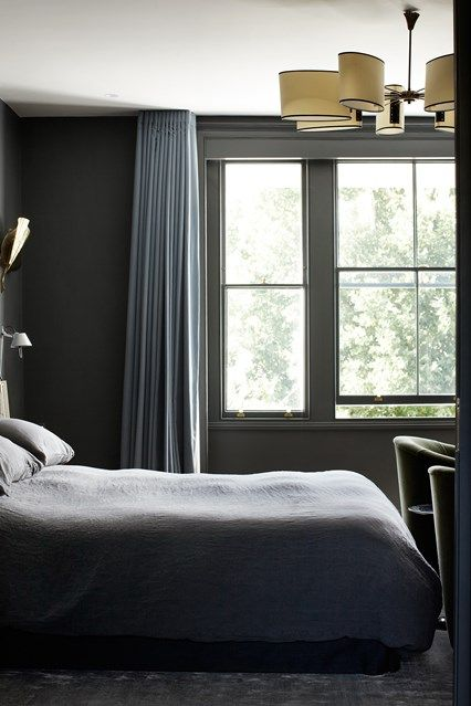 The owner of this bedroom wanted a moody feel, so designer Suzy Hoodless hung grey linen curtains with large pencil pleats from a recessed ceiling track. This keeps out the light and is neater than a pole. Try Silent Gliss for track, from £15.98 for 125cm.  House & Garden.