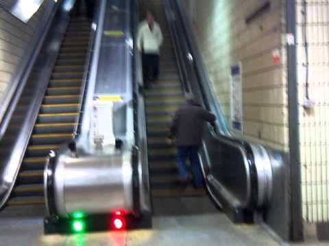 Drunk Glasgow guy goes up the escalator the wrong way!