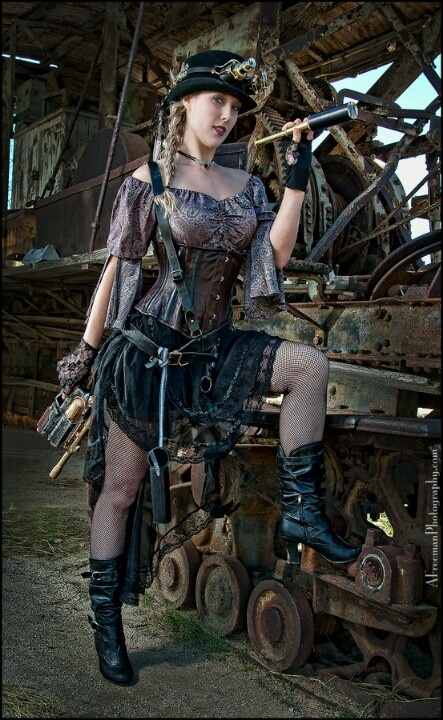 Yes yes.  Girl mechanic.  Steampunk.  Perfect.  Just wish she wasn't blond, but either brunette or redhead.