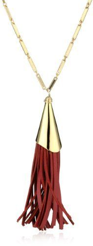 "Nugaard ""Ipanema"" Red Leather and Metal Tassel Necklace Nugaard. $98.00. Trendy tassel pendant, with bar chain and genuine leather tassel, great for layering!. Gold plated bar chain, gold plated tassel cone and genuine leather. Made in USA"