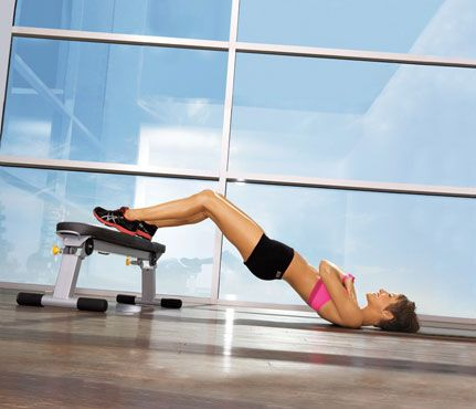 Booty Bridge    Lie faceup on floor with heels on edge of bench, arms crossed at chest. Lift hips, forming a straight line from shoulders to knees (as shown). Lower hips until hovering above floor for 1 rep. Do 15 reps.