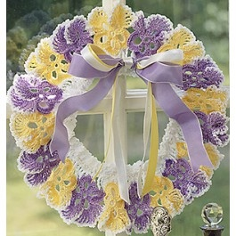 Crochet pansy wreath designed by Anne Halliday. (could not find the pattern but I sure there are lots of patterns for pansies and they could be assembled in a like manner)