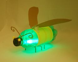 Vuurvlieg. Once made, they can be saved each year and then a new glow stick can be added inside. The kids love flying these around the yard at night!  Could be a fun camping craft