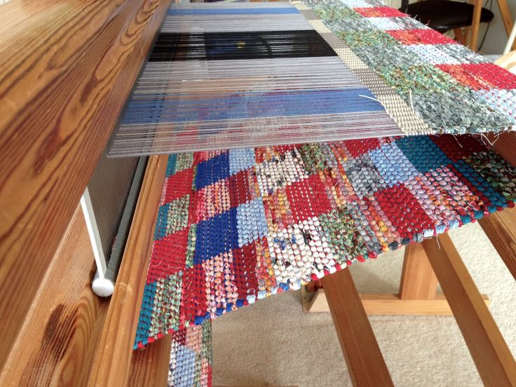 Double-binding rag rug on loom.
