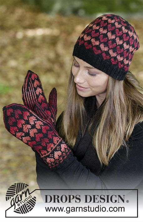 Queen of Hearts  - Set consists of: Hat and mittens with hearts.  Piece is knitted in DROPS Fabel. Free knitted pattern DROPS 183-23