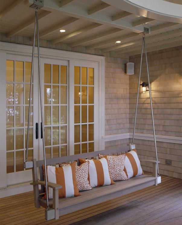 love porch swings.. my next house WILL have a porch with a swing and rocking chairs :) That is my major requirement !