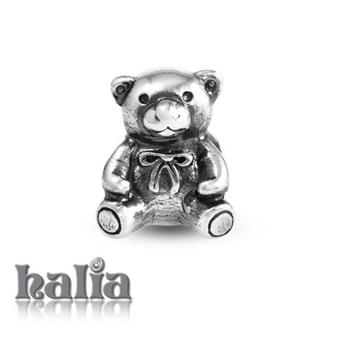 Teddy Bear: Ribboned teddy bear bead: designed exclusively by Halia, this bead fits other popular bead-style charm bracelets as well. Sterling silver, hypo-allergenic and nickel free.     $35.00