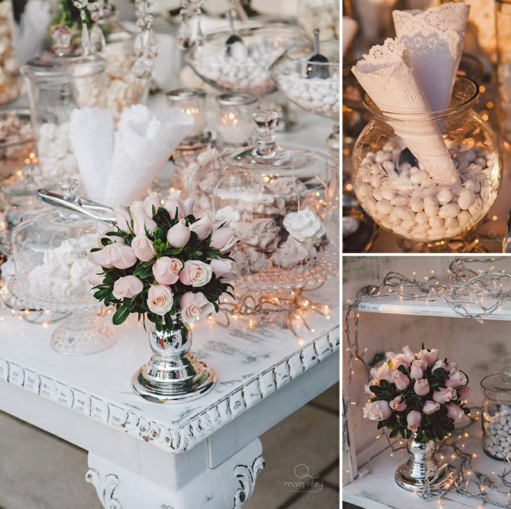 Cute details of the welcome table!Pale pink rose floral composition and several sweets to threat the guests!