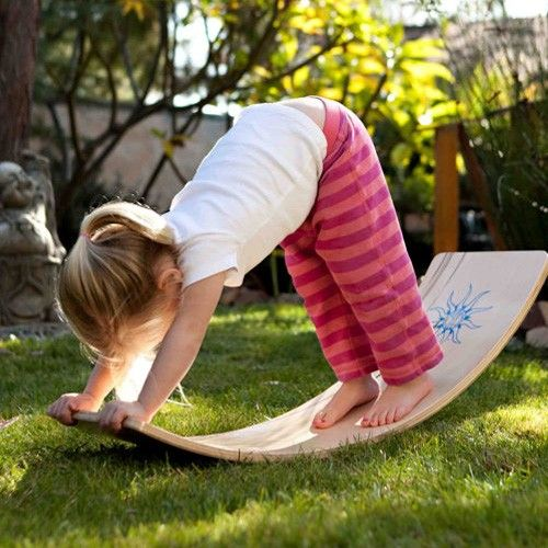Waldorf Rocker Board, Natural Finish. Use as balance board, see-saw, bridge, slide. great for open ended play. I wonder if we could get a board and warp it into shape for less...hmmm