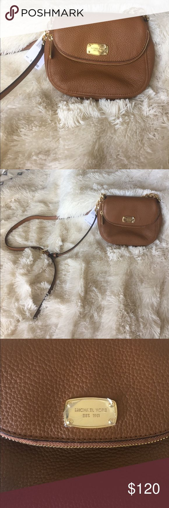 Michael Kors Bedford Flap Crossbody NWT. Never used MK Bedford leather cross body in Acorn. The bag is beautiful but I haven't used it and it deserves to be taken out on the town. Michael Kors Bags Crossbody Bags