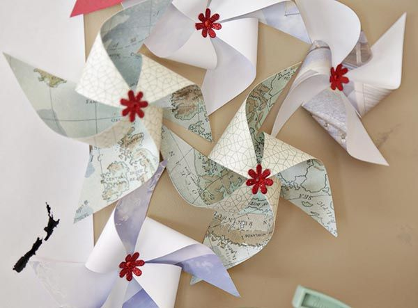 "A ""Welcome to the World"" (World/Travel) baby shower theme with cute map paper pinwheels❣ blovelyevents.com"