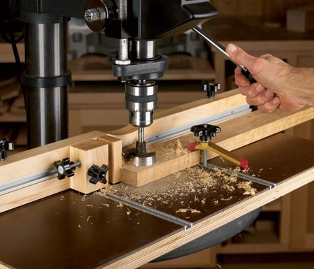 http://www.woodstore.net/plans/shop-plans/jigs-fixtures/1901-Feature-Packed-Drill-Press-Table.html