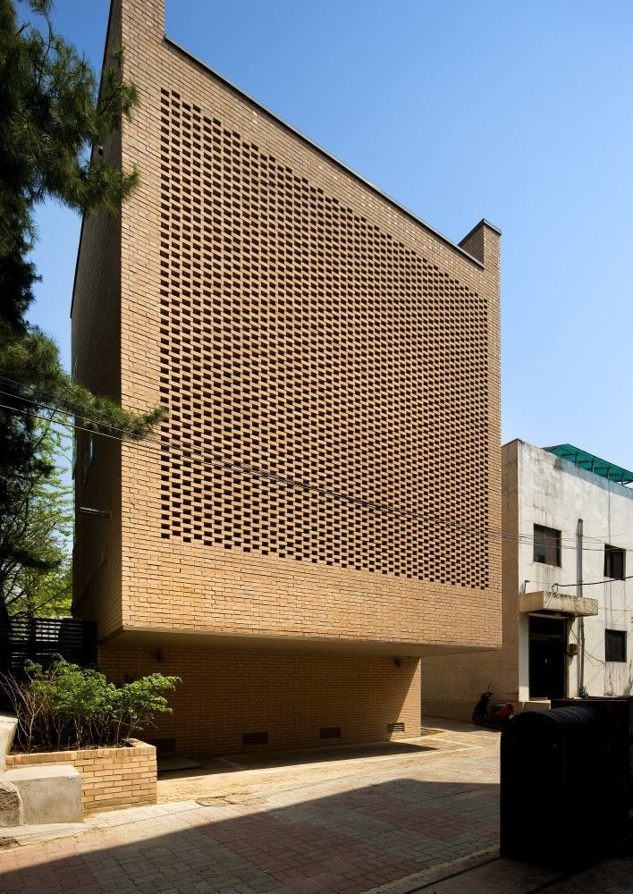 """""""The West Village"""" building   Seoul • Doojin Hwang Architects. """"On the southern facade, a unique brick pattern was used as a visual filter to screen the view of the building in front while allowing sunlight in."""" Doojim Hwang Architects:"""