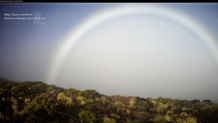 Espectacular #Arcoíris de niebla en Izaña, capturado por la webcam del Observatorio de @AEMET_Esp