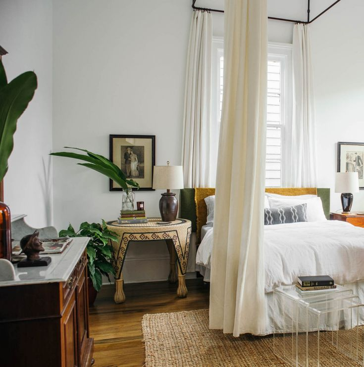 """In the master bedroom, the last room of the house, Rosa found a metalworker to create a dramatic custom canopy out of hollow metal tubing and matching curtain rods. Here, she mixes antique elements with modern: """"I've never felt comfortable just buying a bunch of stuff to fill a room,"""" she says. """"I'd rather work with what I have or what already exists. It's a very intuitive process: Sometimes it's about editing back, or buying old stuff as you're attracted to it, being patient and…"""