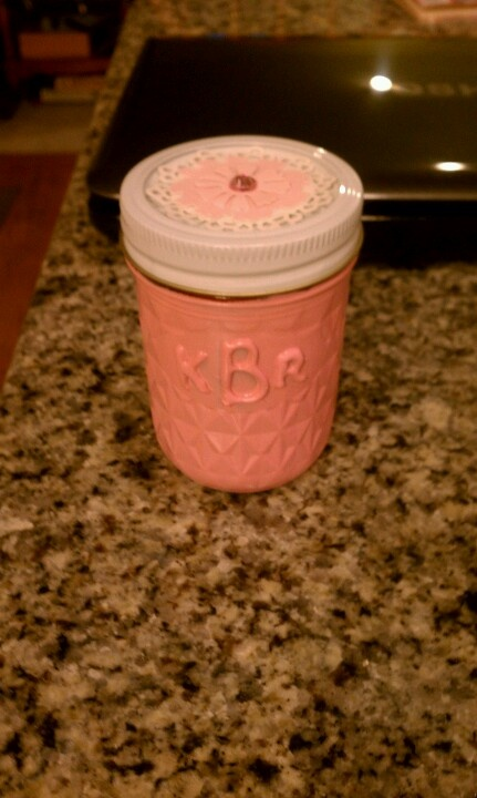 Mason jar with hot glue monogram painted with spray paint and filled with a treat :)