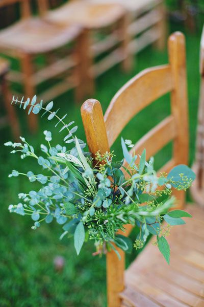 A mix of greens offers a fresh alternative to flowers for accenting the aisle. Tie one — or a few — to center-aisle chairs or pews.