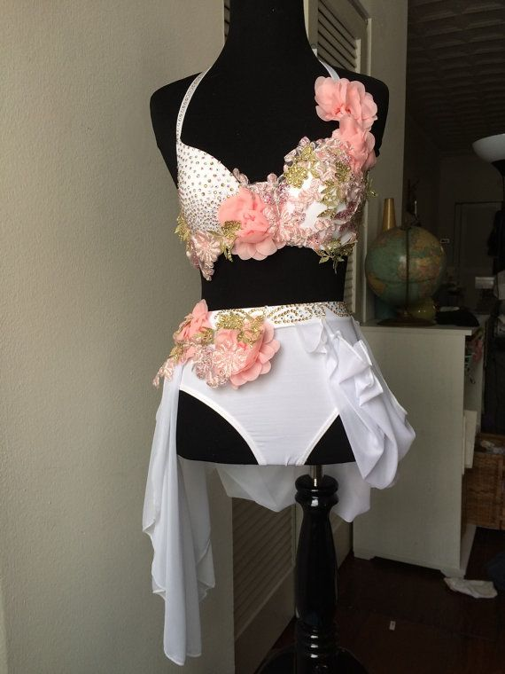 Beautiful one of a kind custom dance costume. Hand sewn and hand stoned with over 1,000 rhinestones and stunning appliqué. This custom costume fits size child large or adult small (bra size adjustable 32-34 A cup) costume includes bra top, skirt and low rise briefs.