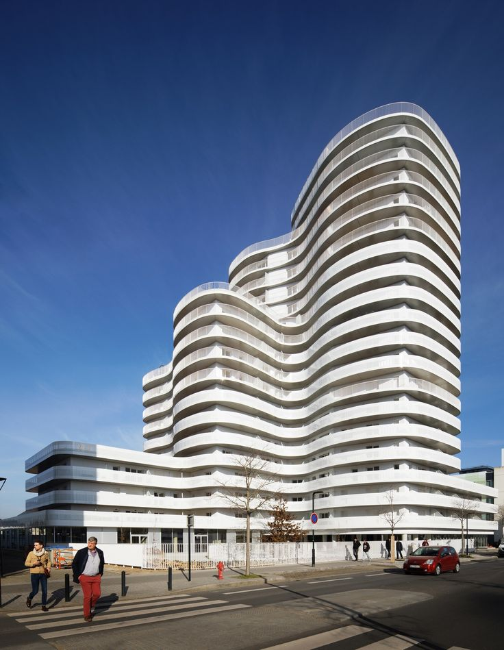 Completed in 2017 in Nantes, France. Images by Takuji Shimmura. . A unique building in a strategic location. Composed of curved angles and surrounded by undulating balconies, New'R pays homage to Oscar Niemeyer as...