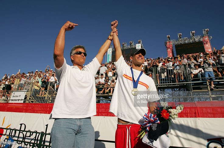 Former Olympian Mark Spitz congratulates Michael Phelps on his win in the 200 meter butterfly final during the US Swimming Olympic Team Trials on July 10, 2004 at the Charter All Digital Aquatic Center in Long Beach, California.