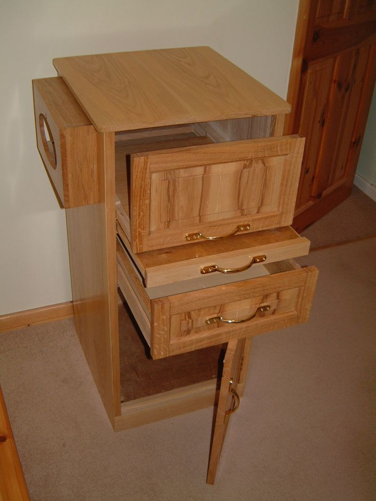 An Oak and Ash Bed side to hold medical equipment