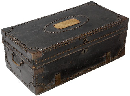 Travelling trunk, believed to have belonged to Macquarie, 1808-1821. Cedar, black hide, brass, metal studs; interior lined with Dutch gilt paper. Lachlan Macquarie was appointed as the fifth Governor of New South Wales in 1809.   Find more detailed information about this photograph: http://acms.sl.nsw.gov.au/item/itemDetailPaged.aspx?itemID=430598   From the collection of the State Library of New South Wales: http://www.sl.nsw.gov.au