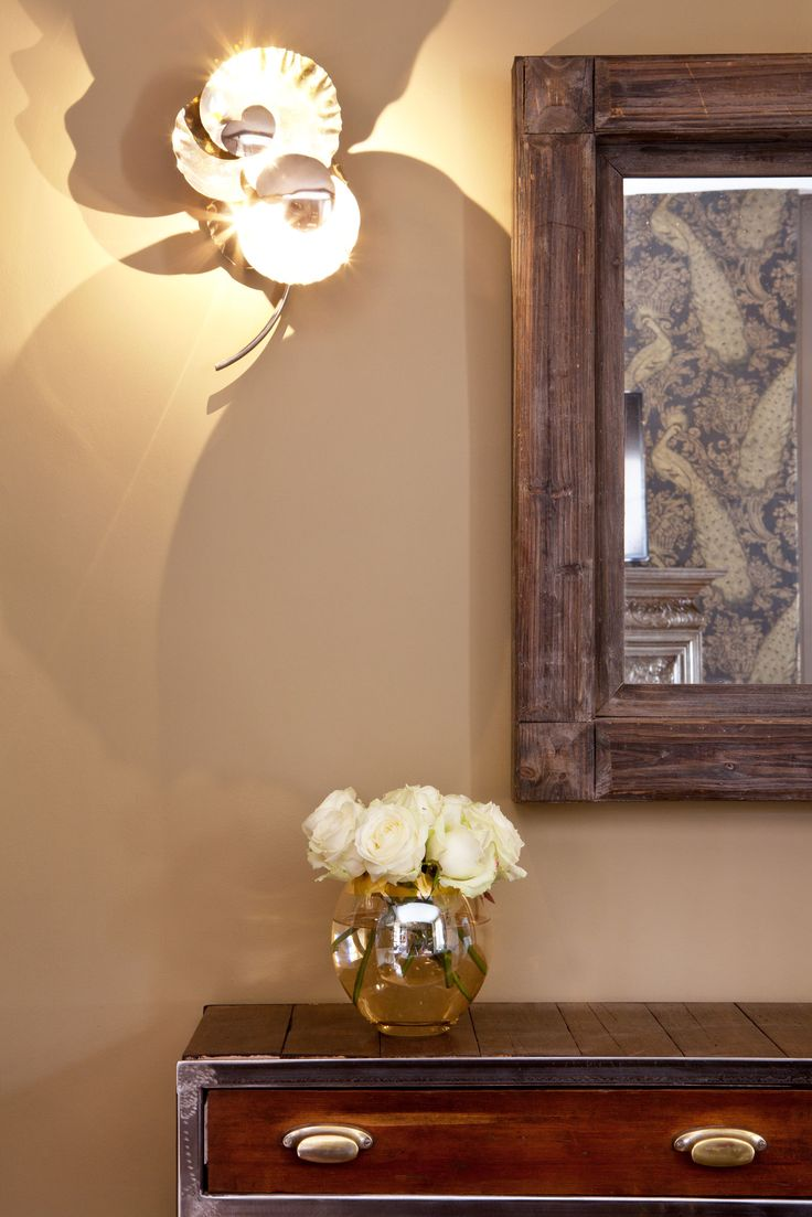 Ochre lighting adds art and atmosphere to the cottage entrance, above our reclaimed hall table.