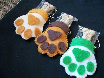LOT OF 3 HAND-SEWN FELT PAW PRINT CHRISTMAS ORNAMENTS W/HANGERS & MILK-BONES on eBay!  Cute idea!