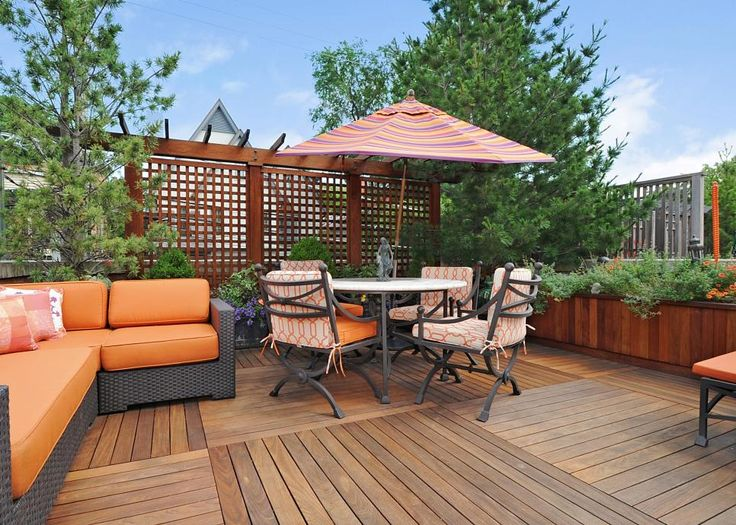 The deck above the garage, all decked out with a tangerine-y outdoor sofa, wrought iron furniture and wooden screen dividers. This is close to the patio, perfect for a summer mash-up of friends. See the  Zillow listing.