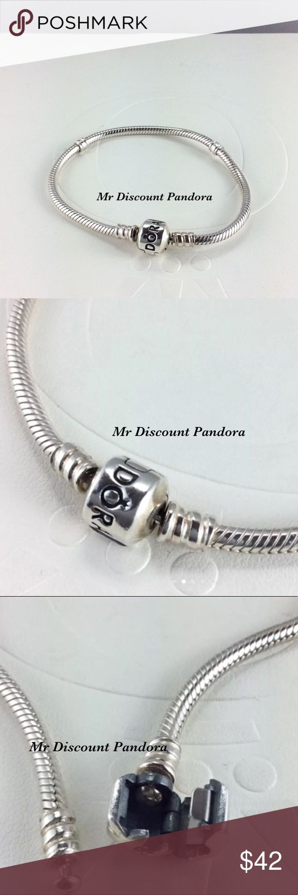 """6.9"""" Pandora Iconic Silver Bracelet This sterling silver charm bracelet is the most popular PANDORA bracelet. Its design features a barrel charm clasp and our innovative threading system, which makes it easy to screw PANDORA charms onto your bracelet and keep them securely where you want them. This is the perfect style to start or add to your charm collection.  Condition: Gently used (Not stiff)  Retail new $70.00 including taxes  Add a Pandora box for $4 more  Bundle/Offer for discount…"""