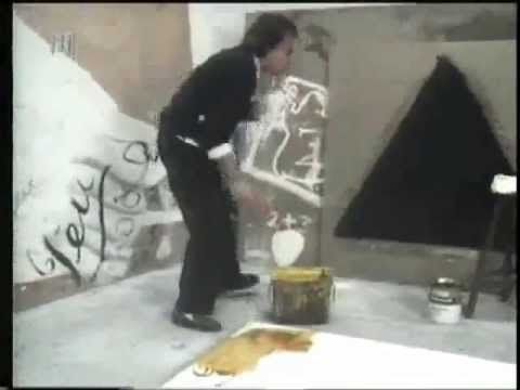 Antoni Tapies in his studio. Fabulous! What is the white powder he pours onto the wet canvas???? Anyone?