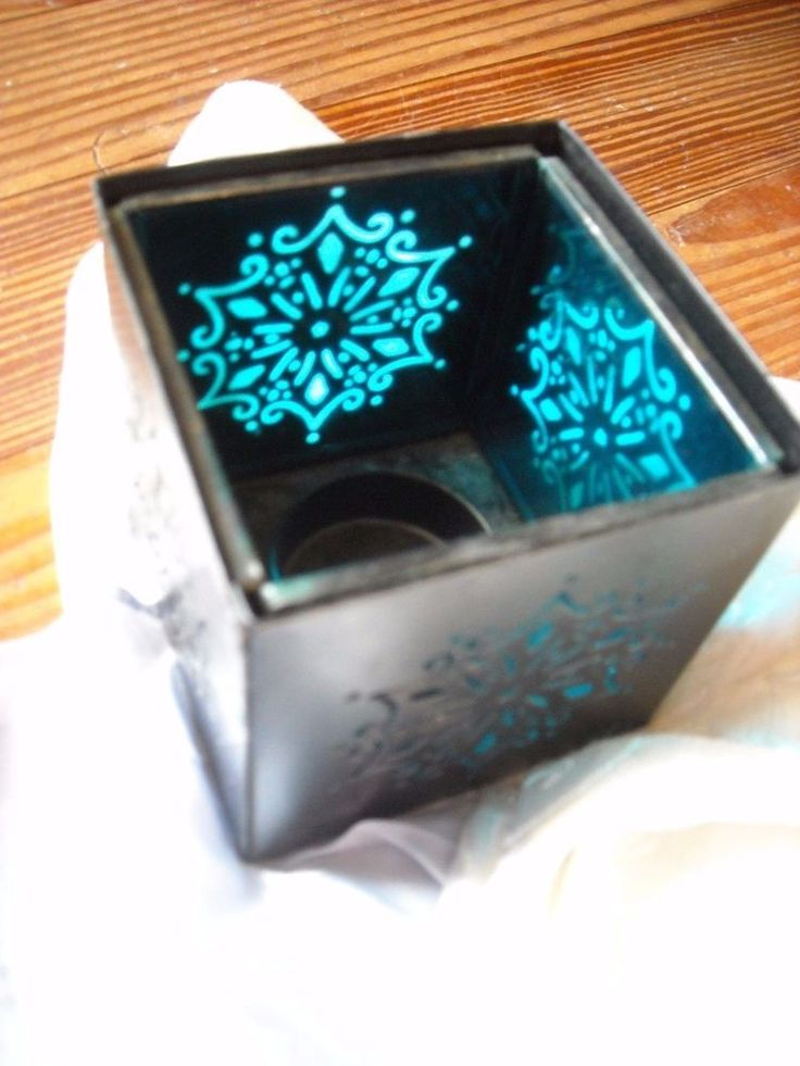 """Blue glass and black metal  for sale in my store The Chic N Prim cottage ebay have to put in the """"the """" in search engine $4 FREE Shipping when you spend $30 or more!candle holder cut out design decoration home accent"""