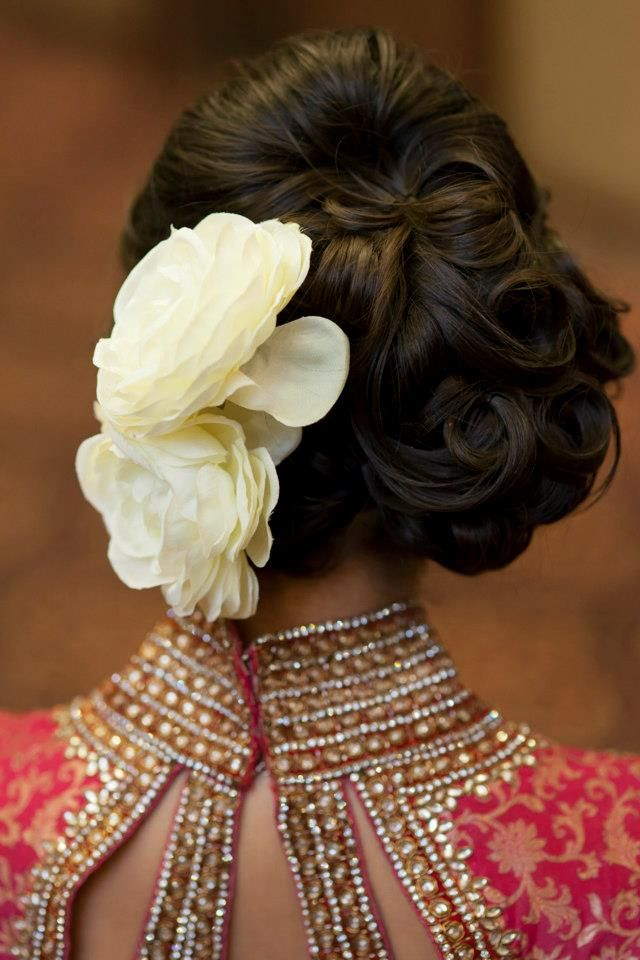 Giant flowers with a bun - never goes outta style. #indian #wedding