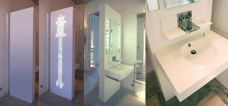 Tabique separador con lavabo integrado y trasera retroiluminada realizado en LG Hi-Macs®. Diseño exclusivo.