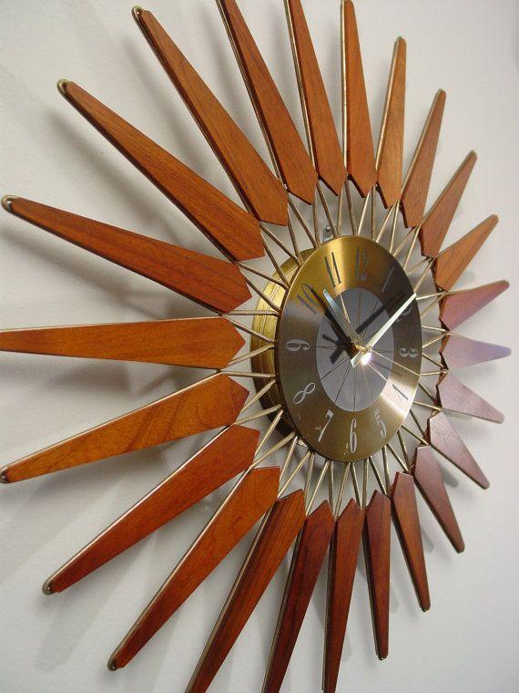 Mid-Century starburst clock by ClubModerne,. Brass and teak.