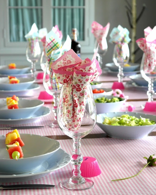 pretty floral and plaid napkins, pink gingham wrapping paper for a runner and muffin cups for place cards!