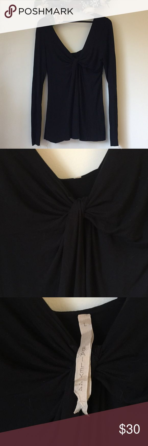 Bailey 44 black blouse in Large This is a gently used Bailey 44 Blouse in size large. The color is black and there are no holes or stains on this blouse. It has a very stretchy and soft material. With a V neck line Bailey 44 Tops Blouses