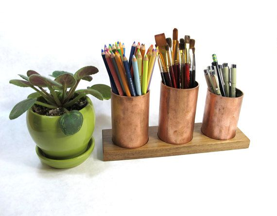 Copper is the ancient/traditional seventh anniversary gift. Desk sets are the modern gift. Combine them with this commemorative copper and wood desk organizer.