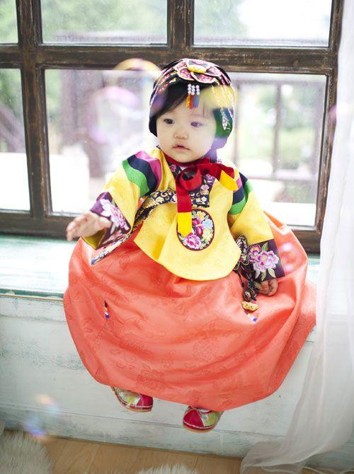 .cute little Korean baby wearing a Hanbok.