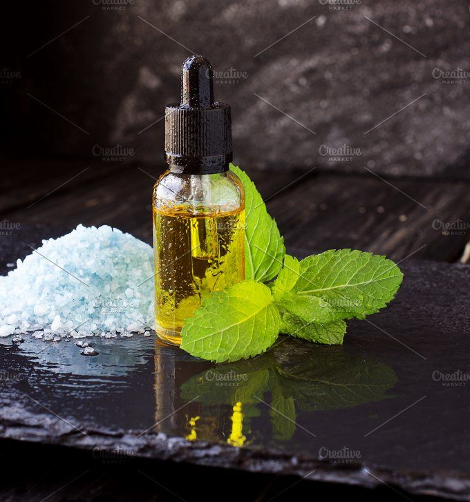jar of menthol oil, selective focus, space for text Photos jar of menthol oil, a sprig of mint and salt on black stone table for spa, selective focus, space fo by Wild Drago Shop