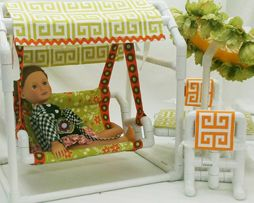Toys for dolls—playground, swimming, dance, gymnastics, and other play areas and accessories.