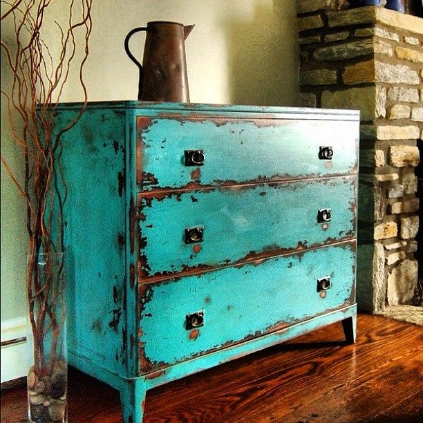 Attractive Distressed Turquoise Drawers Add Color To A Dark Space.