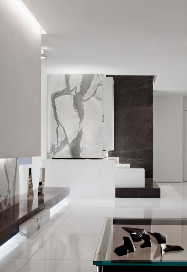 A dark two level space gets a dramatic renovation dark for Schlesinger associates