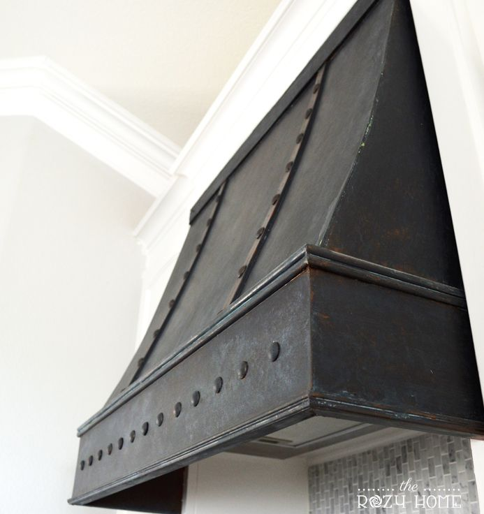 DIY Bronze Range Hood. Tired of your boring range hood? Create your own DIY bronze range hood using Modern Masters Metal Effects and inexpensive decorative tacks.
