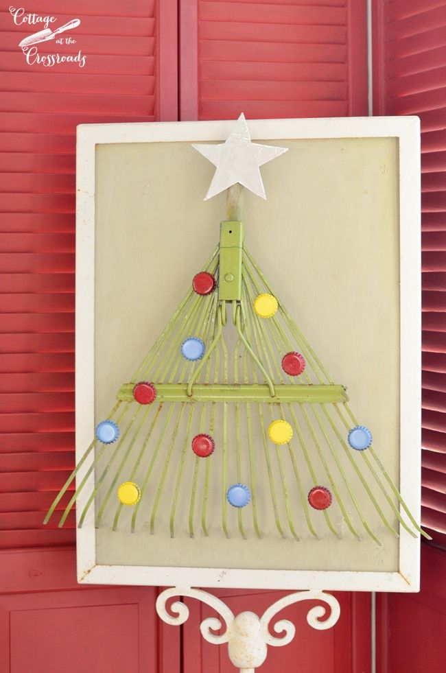 Adorable Christmas tree made from an old garden rake and bottle caps!