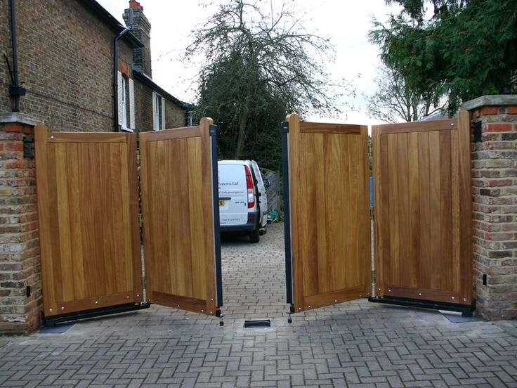 The 25 best ideas about wooden gates on pinterest for Wooden sliding driveway gates