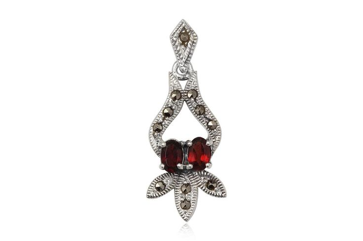 Pandantiv deosebit din argint 92.5%, decorat cu granate si marcasite. http://www.lafemmecoquette.ro/pandantiv-oriental-din-argint-si-granate/
