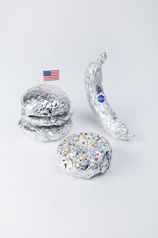 <p>Breaking news! The United States has just landed on Planet Hamburger. Decked out in tin foil, these foods are ready for space. With a banana spaceship, a constellation doughnut and of course a hamb