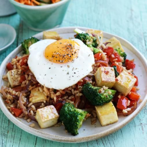 Nasi goreng with fried egg, pickled cucumber and carrot recipe #yummy