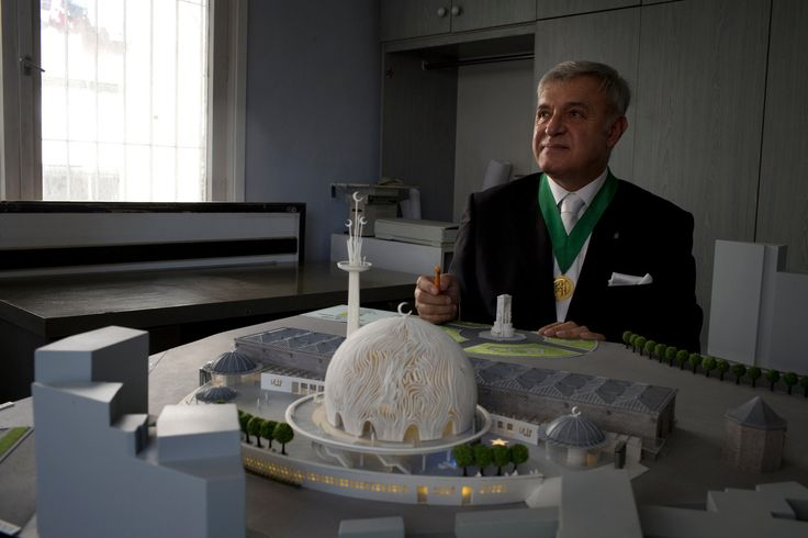 The controversy over Taksim includes the rebuilding of the Ottoman barracks in Gezi Park as well as a plan for a mosque. The photo shows the latest model of a mosque designed for Taksim Square. In the background in white, near the architects hands, is the monument to the Republic. June 23, 2013 NY Times.